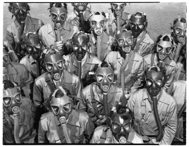 Denver's Woman Marine Reservists wearing gas masks