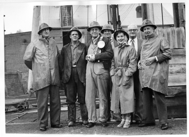 Australia Fieldwork- Alfred Bailey and Pat Witherspoon with miners in front of the Central Deborah Gold Mine