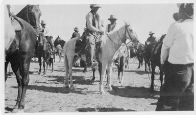 Portrait of Ute men on horseback