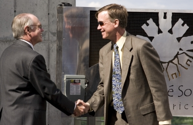 George Sparks and Mayor John Hickenlooper shake hands