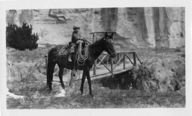 Alice riding a horse.