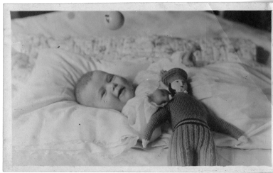 Baby with doll