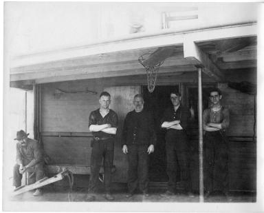 5 men on a boat