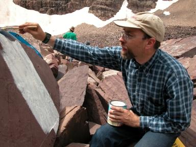 Frank Sanders applying molding latex to trackways.