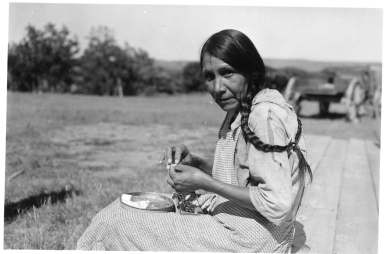 Sioux woman doing beadwork