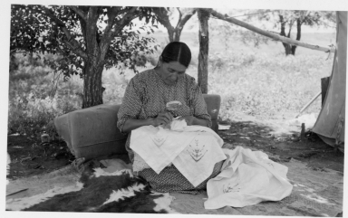 Sioux woman doing needlework