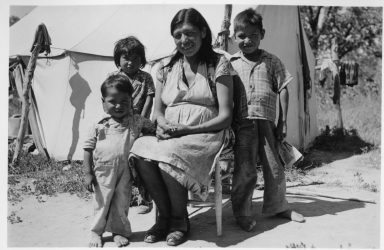 Sioux woman with three children