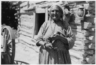 Old Sioux woman with puppy