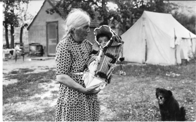 Old Sioux woman with baby in cradleboard