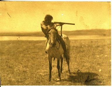 Indian with rifle