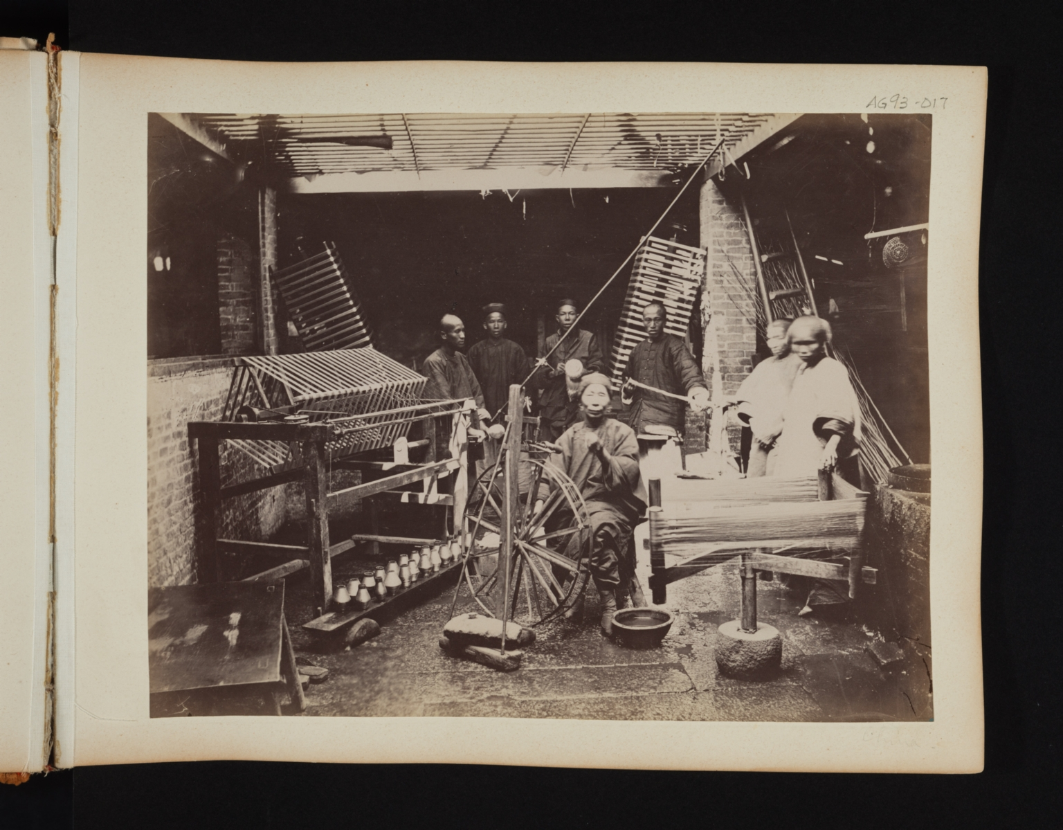 Group of chinese men in a textile workshop.