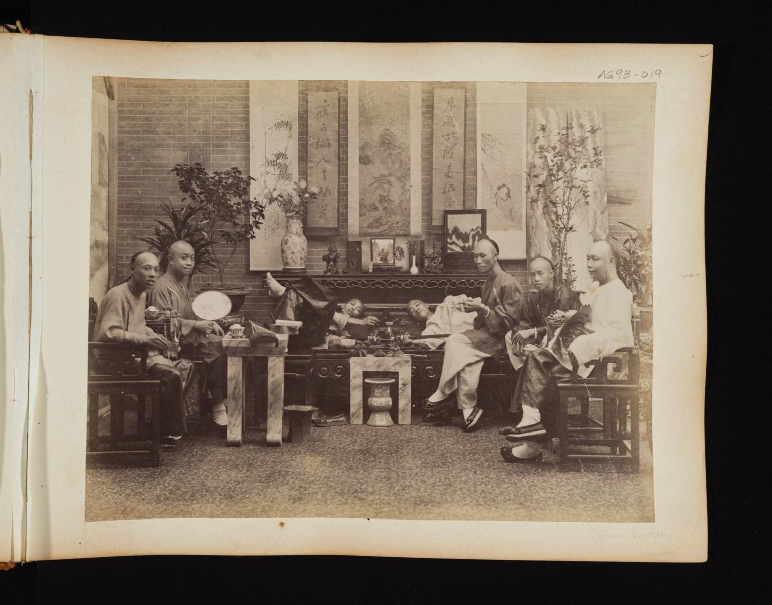 Group of seven men in an opium den in China.