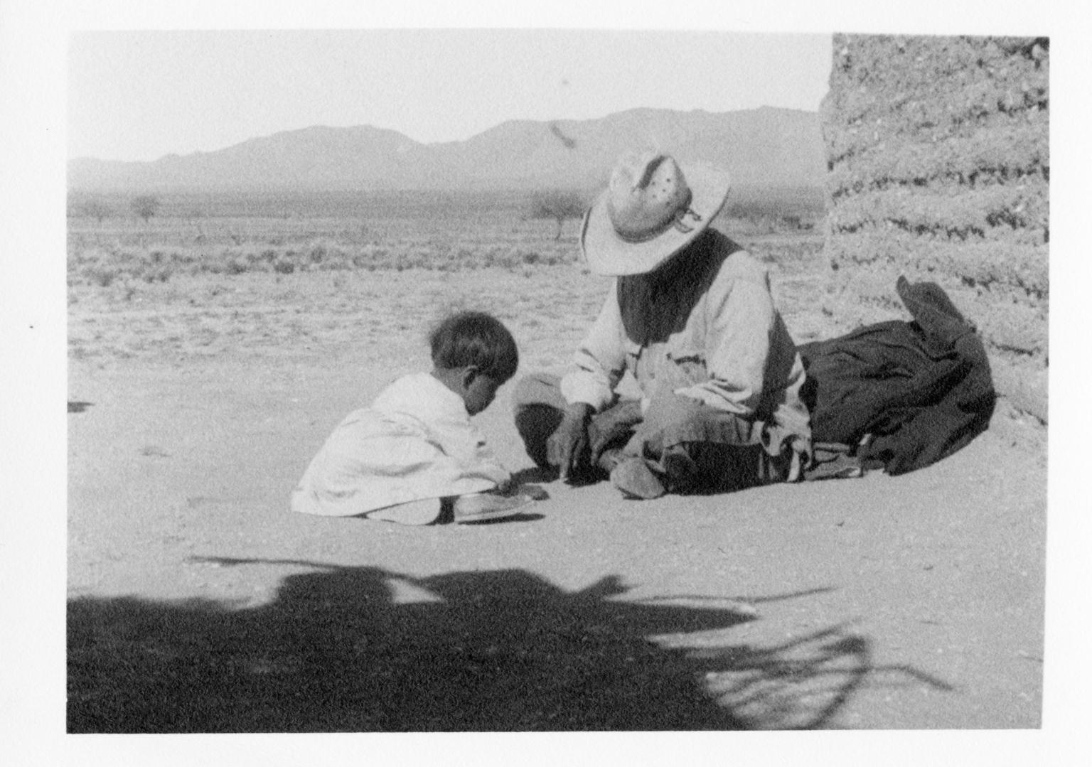 Unidentified Tohono O'odham man and child