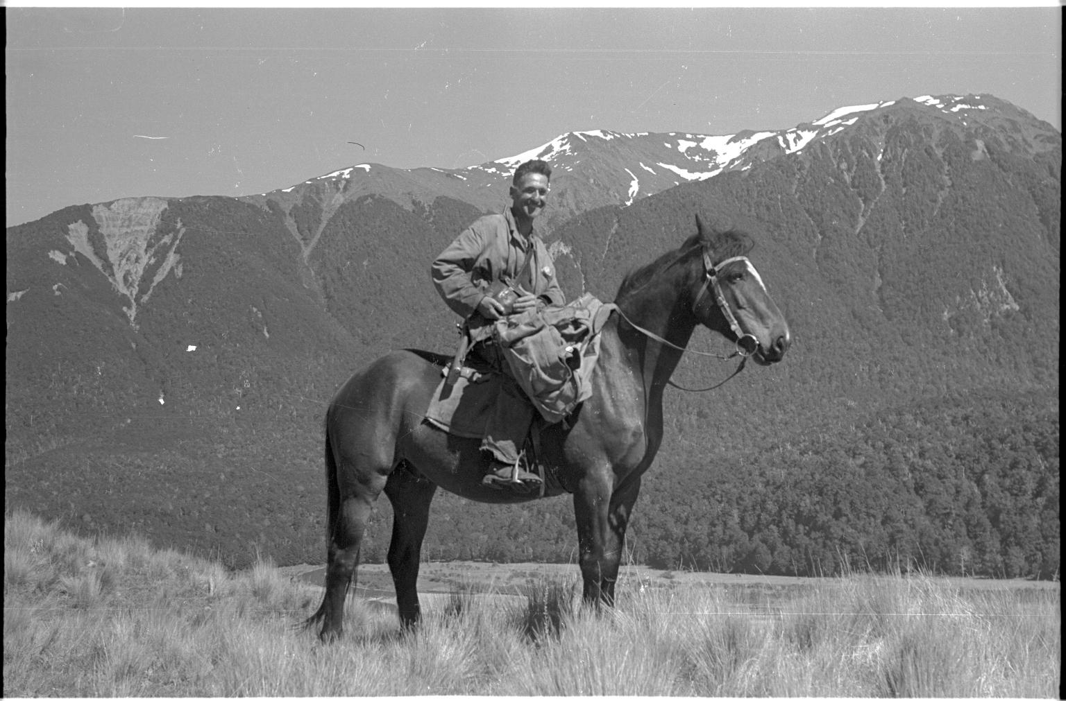 Dick Morris on horseback near Lewis Pass