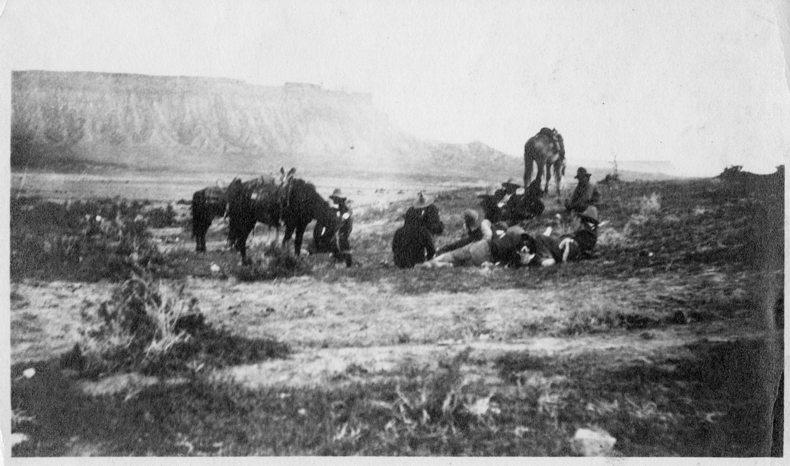 Portrait of Ute men with horses