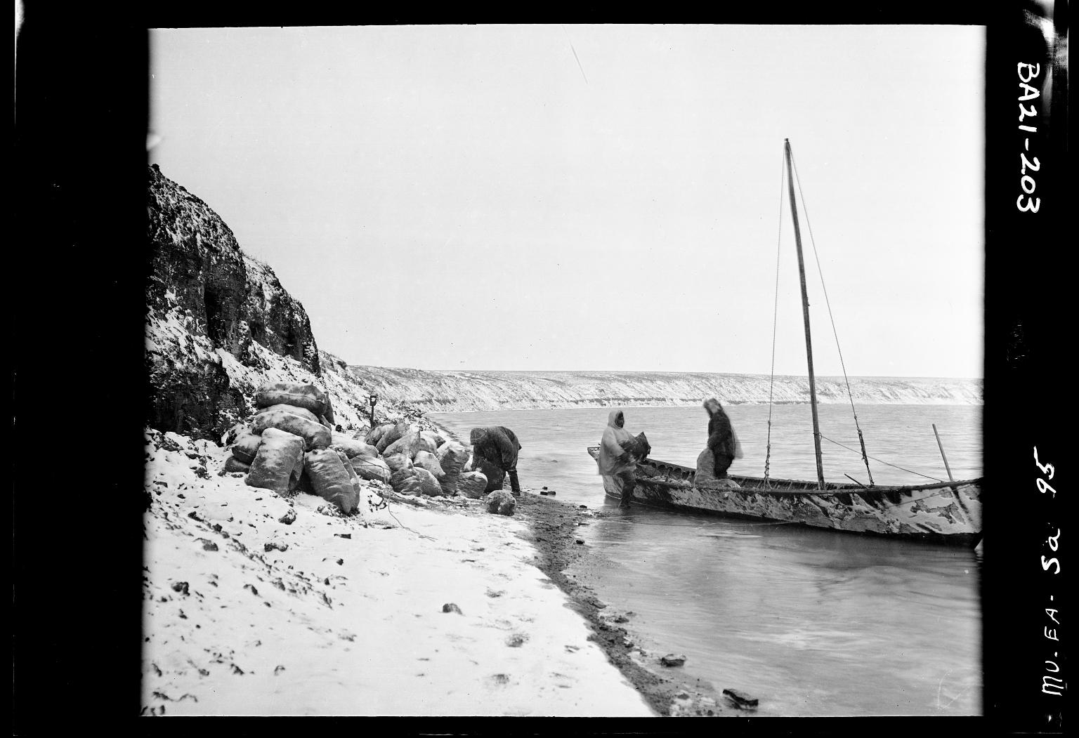 Eskimo men loading coal