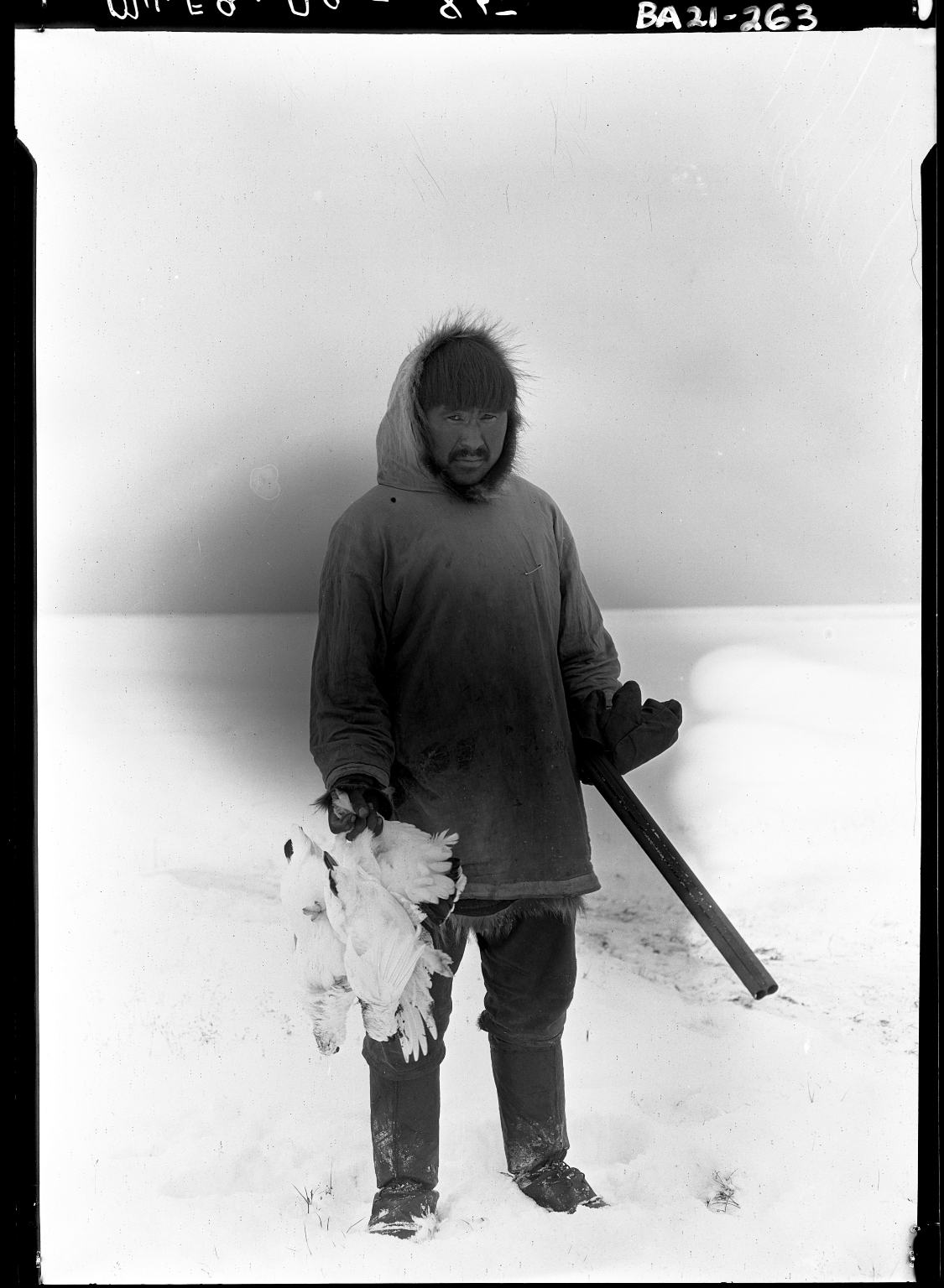 Togaruk with a ptarmigan specimen