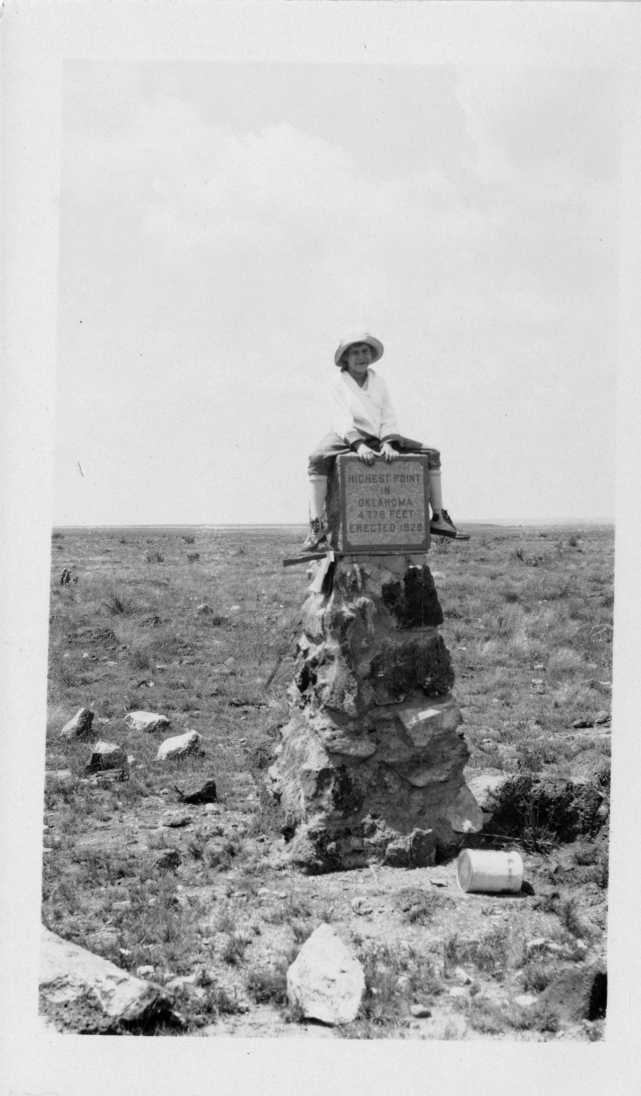 Alice sitting on Oklahoma marker