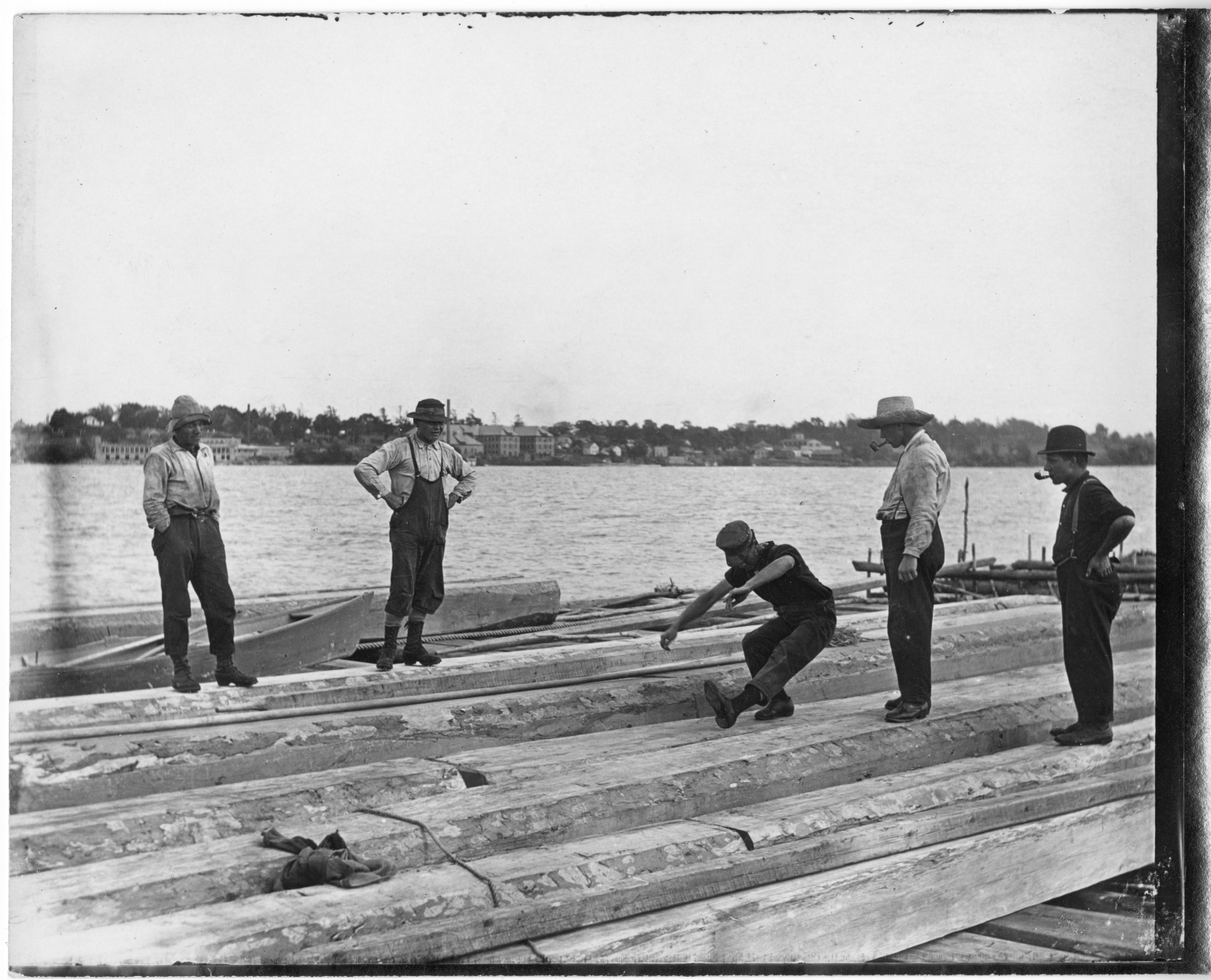 Men aboard a log raft
