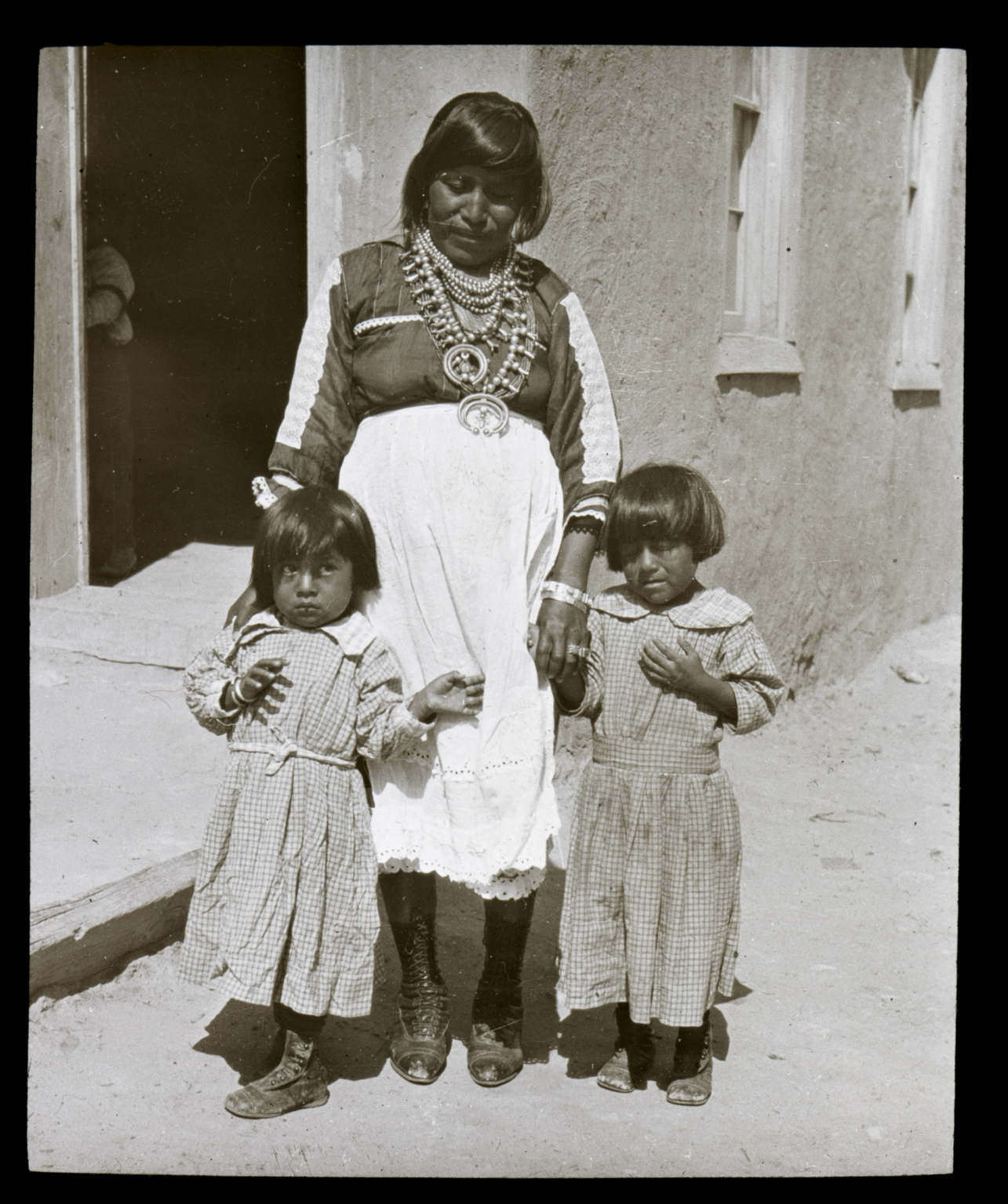 Acoma woman and children