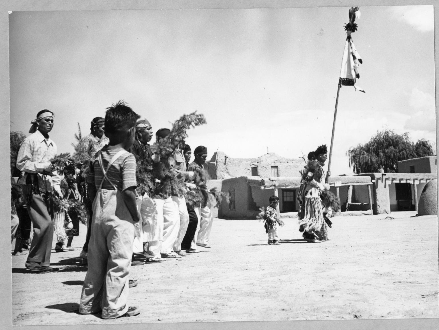 San Ildefonso Pueblo, Corn Dance. Chorus advancing from Kiva to Plaza