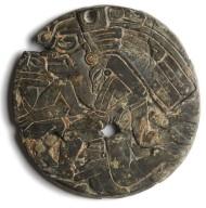 Circular carved slate mirror