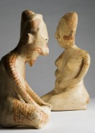 Two painted pottery figures, male & female