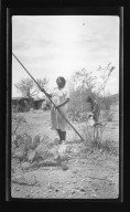 Women Holding Stick for Cactus Gathering