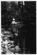 Unidentified woman fishing in mountain stream