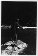 Unidentified man fishing in mountain stream