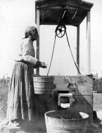 Mexican woman at well