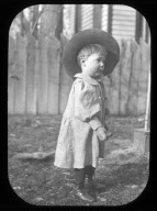 Toddler in hat with broom