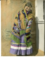 """Young Apache woman wearing """"dress-up"""" clothes"""