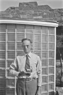 H.H. Nininger holding small fragments