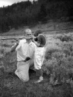 Robert Landberg and girl shooting rifle