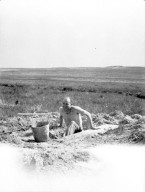 Worker at unidentified dig