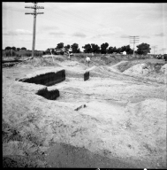 Excavation site with bones and projectiles