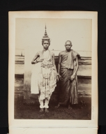 Portrait of two men, one in native dress, and one in costume.