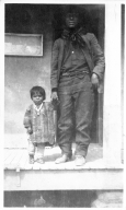 Portrait of a Ute Mountain Ute man and child