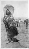 Portrait of a Ute woman with a cradleboard