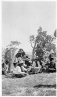 Portrait of Ute men sitting around a drum