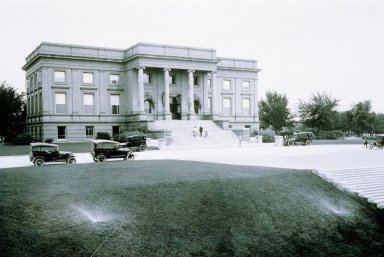 View of automobiles and people in front of Colorado Museum of Natural History, Standley Wing.