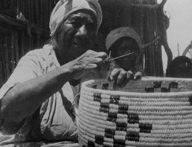 Chona Weaving a Basket