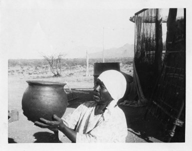 Women holding up a finished pot