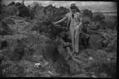 Man Standing by Rocks