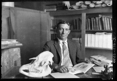 Harold J. Cook at his desk