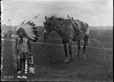 Boy in native dress and horse