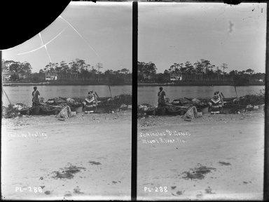 Seminoles and canoes at Miami River