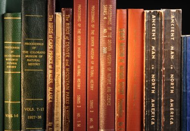 Shelf containing proceedings of the Denver Museum of Nature and Science and its predecessors.