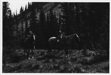 2 unidentified women on horseback